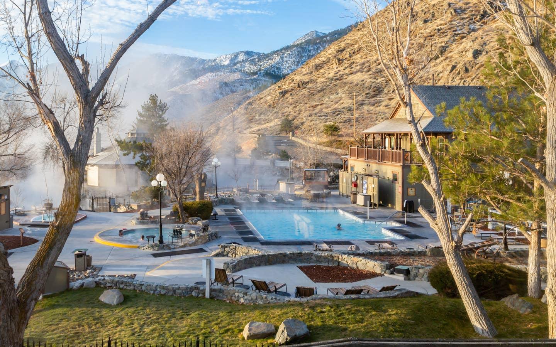 View of outdoor pool and hot springs spa tubs at David Walley's Resort in Genoa, Nevada