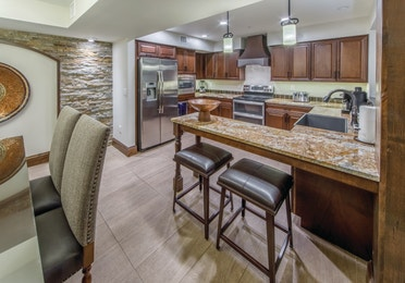 Kitchen with custom cabinetry and granite countertops in a Three-Bedroom Signature Collection Villa at the Scottsdale Resort in Arizona
