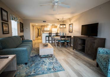 Open concept living, dining and kitchen area in a two-bedroom villa at Cape Canaveral Beach Resort.