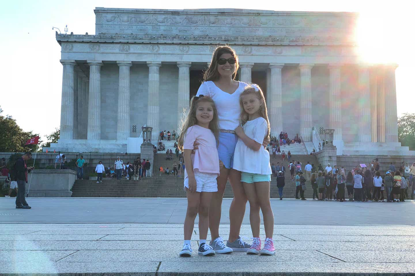 Author, Chris Johnston (middle), stands in front of the Lincoln Memorial in Washington DC with her daughters Kyndall (right) and Kyler (left).
