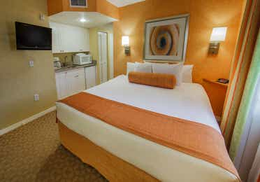 View of the bed and kitchen in a studio villa at Cape Canaveral Resort