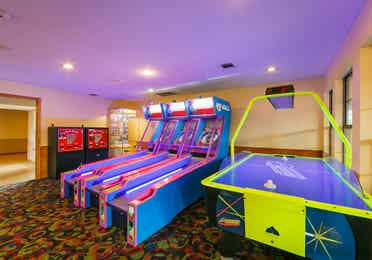 Arcade with skee-ball and air hockey at Hill Country Resort in Hill Country, Texas.
