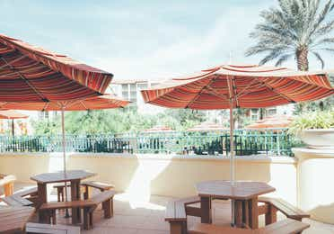 Outdoor seating with umbrellas in River Island at Orange Lake Resort near Orlando, Florida