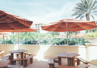 Outdoor seating with umbrellas in River Island at Orange Lake Resort near Orlando, Florida