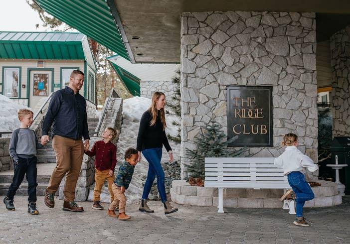 Family with four kids walking into Tahoe Ridge Resort at Stateline, Nevada.