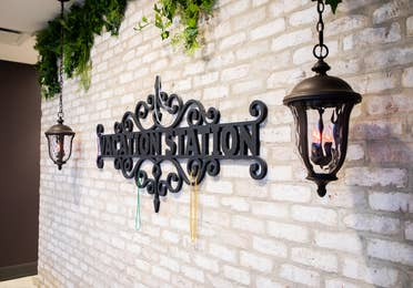 Sign of Vacation Station on light brick wall at New Orleans Resort in Louisiana.