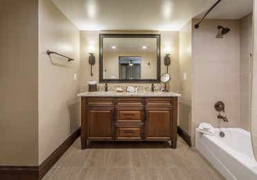 Bathroom vanity with large mirror and wall sconces in a Two-Bedroom Signature Collection villa at Scottsdale Resort in Arizona