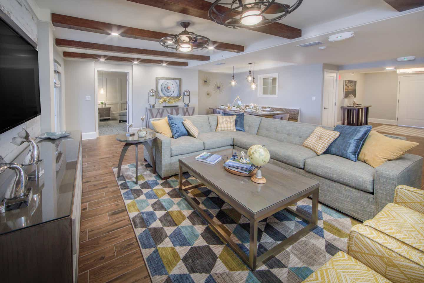 A living room in a four-bedroom Signature Collection villa at Cape Canaveral Resort