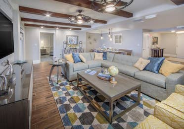 A living room in a four-bedroom Signature Collection villa at Cape Canaveral Resort.