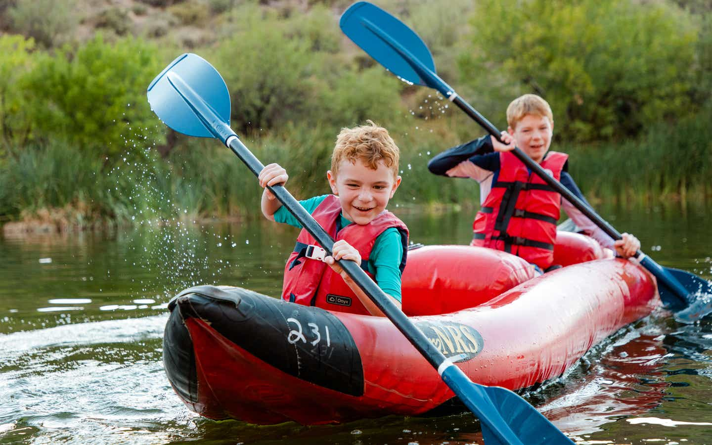 Two young children kayaking near Scottsdale Resort.