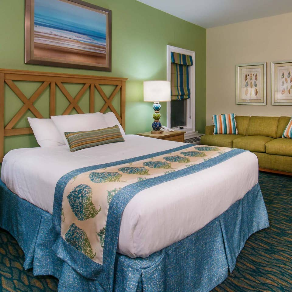 Studio room with a bed, couch and sitting area at South Beach Resort in Myrtle Beach, South Carolina.