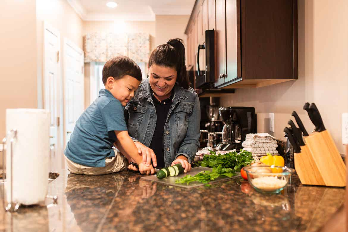 Featured Contributor, Angelica Kajiwara (right), and her son prep food in the villa kitchen of our Williamsburg resort in Williamsburg, Virginia.