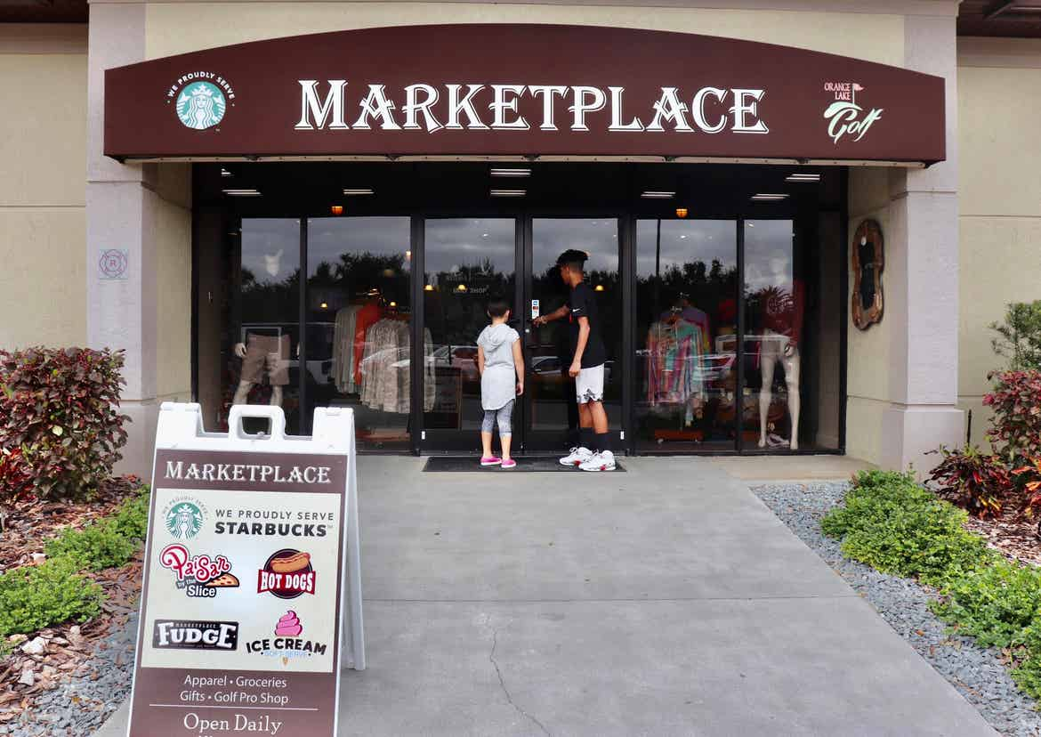 clarissa's kids standing in front of the Marketplace at Orange Lake Resort