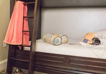 Twin bunk beds with children's toys in a villa in River Island at Orange Lake Resort near Orlando, Florida