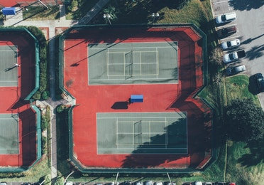 Aerial view of outdoor tennis courts in West Village at Orange Lake Resort near Orlando, Florida