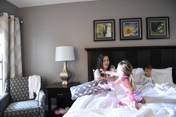 Mother in a hotel room with her children