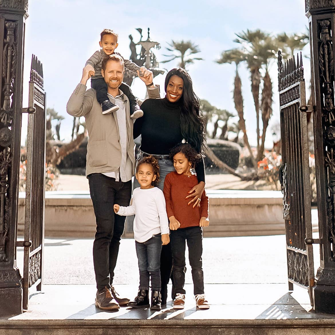 Featured Contributor, Sally Butan of @butanclan (top-right) stands with her husband, Kevin (top-left), and their children pose in Jackson Square of New Orleans, Louisiana.