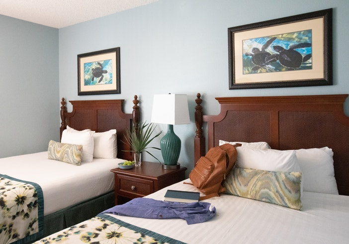 Bedroom with two beds in a villa in East Village at Orange Lake Resort near Orlando, Florida