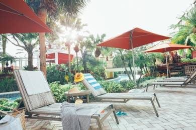 Beach chairs next to a pool at Orange Lake Resort near Orlando, Florida