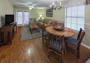 Dining and living room area in a three-bedroom ambassador villa at the Hill Country Resort in Canyon Lake, Texas.