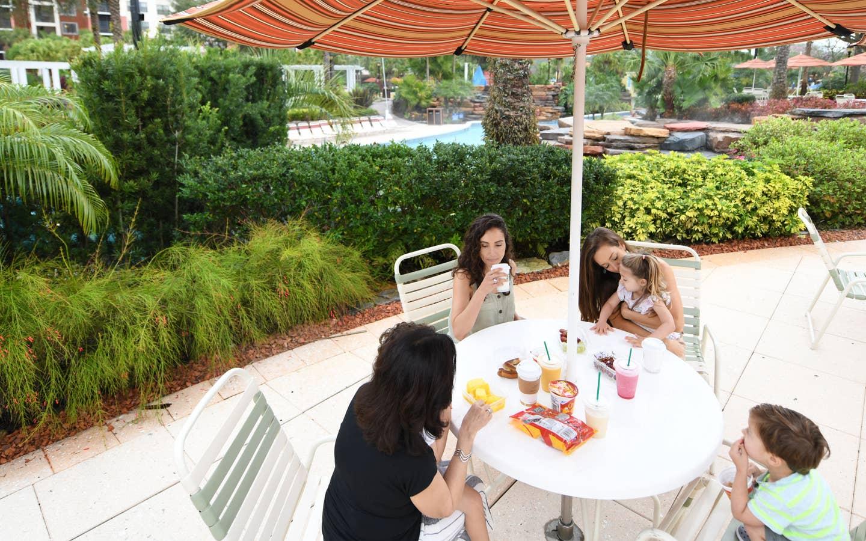 Group of people eating outside of Anchors at Orange Lake Resort near Orlando, Florida.