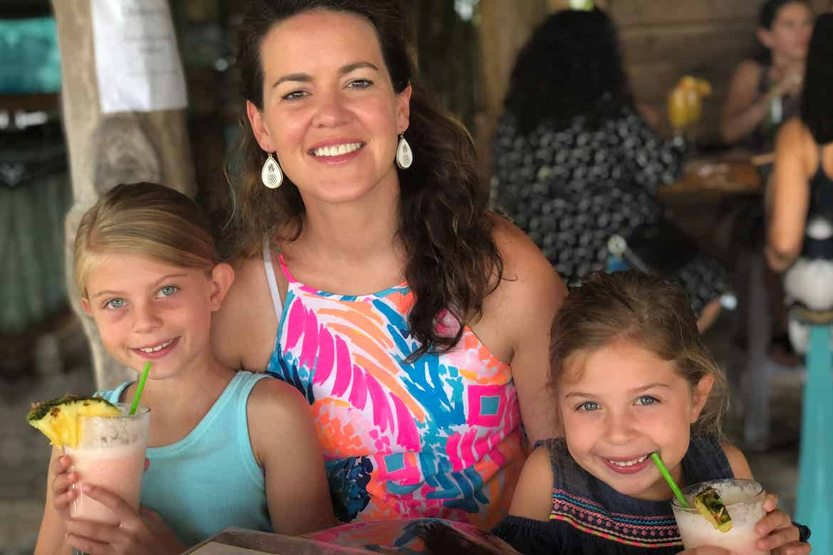 Featured Contributor, Chris Johnston's two daughters, Kyler (right) and Kyndall (left), drink virgin Pina Coladas with family friend and Checking In Editor-in-Chief, Jenn C. Harmon (middle).