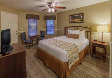 Guest bedroom in a two-bedroom villa at Villages Resort