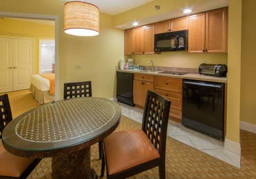 Small dining area and kitchenette in a one bedroom villa in West Village at Orange Lake Resort near Orlando, FL