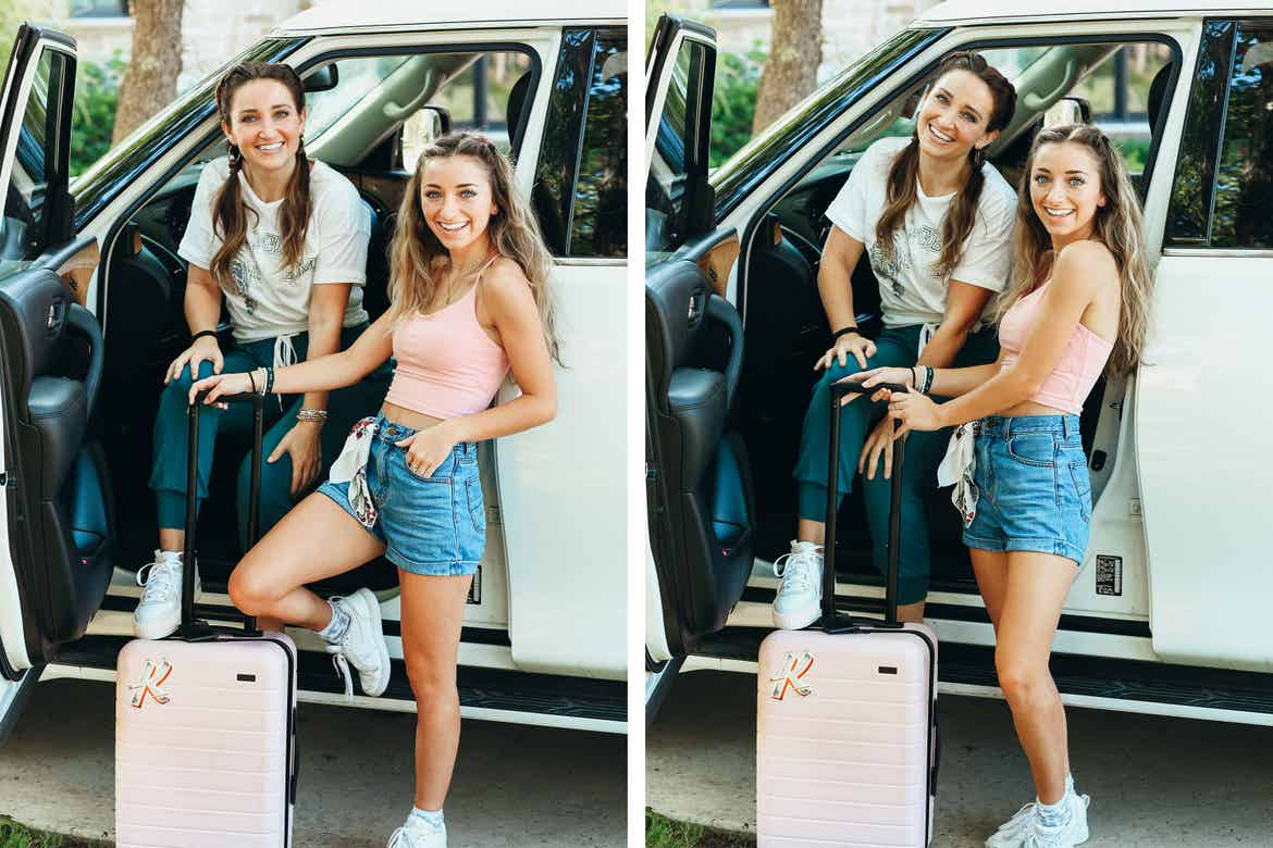 Mindy and her daughter pose in front of their SUV with along with a pink suitcase with hair essentials in tow.