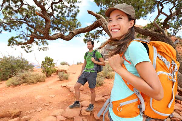 Two people hiking in a desert area