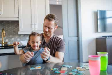 Featured Contributor, Sally Butan of @butanclan's husband, Kevin (right) and her son (left) enjoy puzzles in our Signature Collection villa at our resort in New Orleans, Louisiana.