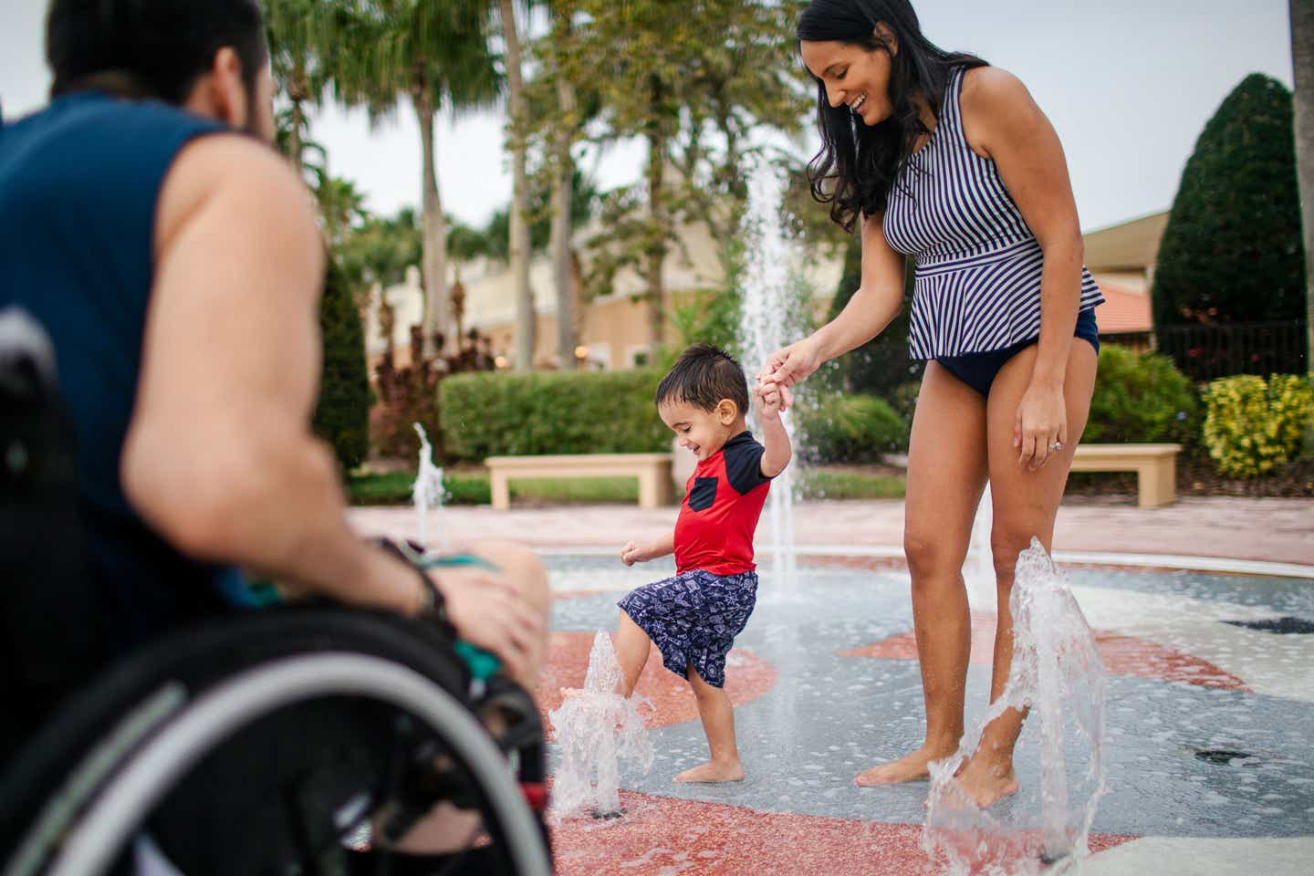 Author, Danny Pitaluga (left), his wife, Val (right) and son, Joey (middle), wear their swimsuits near a fountain park area at our Orange Lake Resort located in Orlando, Florida.