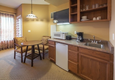 Kitchenette with microwave and mini-fridge and small dining area in a studio room at David Walley's Resort in Genoa, Nevada