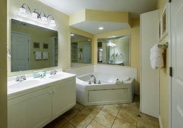 Bathroom with tub in a villa at Orlando Breeze Resort.