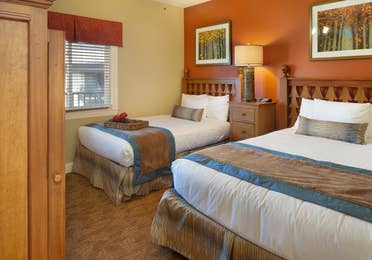 Bedroom with two beds in a villa at Smoky Mountain Resort in Gatlinburg, Tennessee.