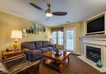 Living room with fireplace in a two-bedroom ambassador villa at the Holiday Hills Resort in Branson Missouri.
