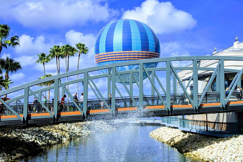 Disney springs Aerophile in the background of a bridge crossing at Walt Disney World Resort.