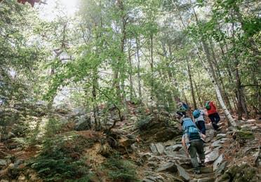 Family hiking near Oak n' Spruce Resort in South Lee, Massachusetts.