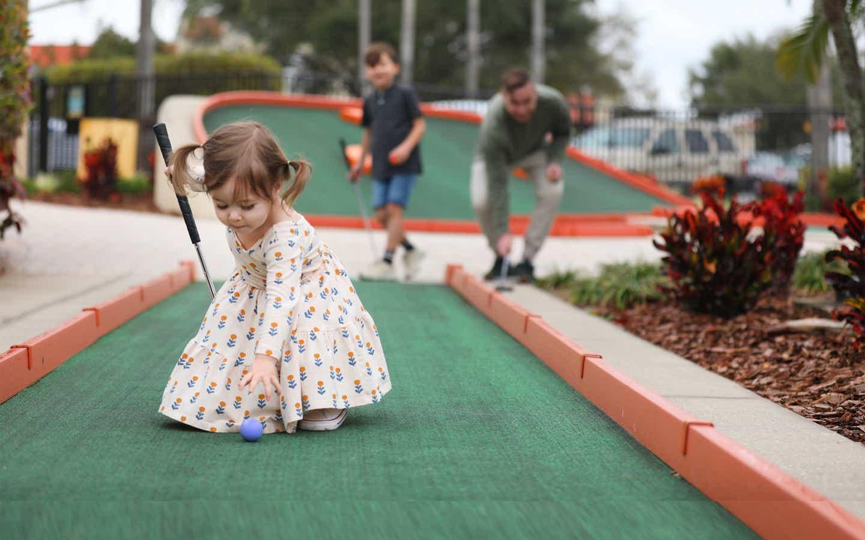 Young child playing mini golf at Orange Lake Resort near Orlando, Florida.