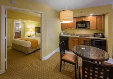 Kitchenette and small dining area with view of bedroom in a one bedroom villa in West Village at Orange Lake Resort near Orlando, FL