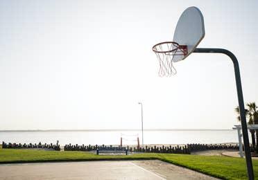 Outdoor basketball court at Villages Resort in Flint, Texas.