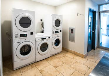 Washer/dryer area with five machines at New Orleans Resort in Louisiana.