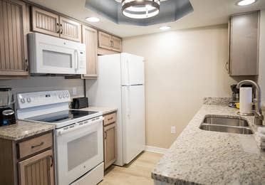 Full kitchen with fridge, oven and microwave in a two-bedroom villa at Cape Canaveral Beach Resort.
