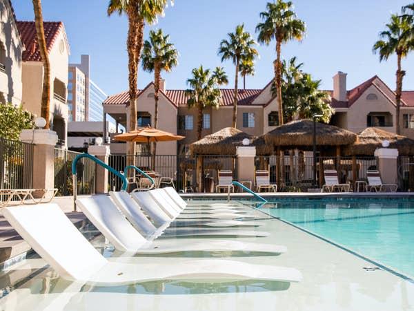 Sun chairs in lounge pool at Desert Club Resort in Las Vegas, Nevada.