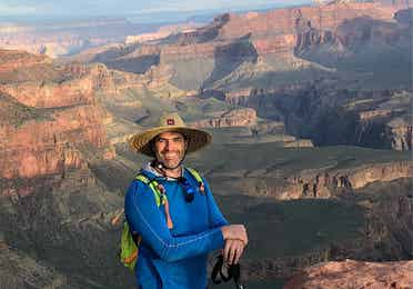 Man standing in front of Grand Canyon near Scottsdale Resort.