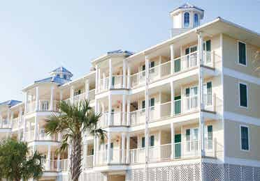 View of property building with balconies at Galveston Seaside Resort in Texas.