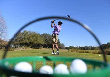 View of golfer swinging club at Orange Lake Resort near Orlando, Florida