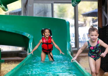 Two toddlers coming off of a waterslide at the Waterpark at the Villages