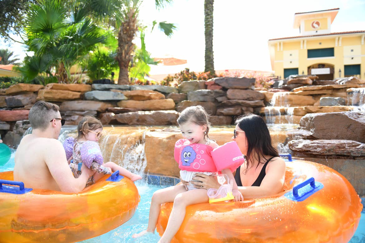 Mia St Clair and her family tubing in the lazy river in River Island at Orange Lake Resort