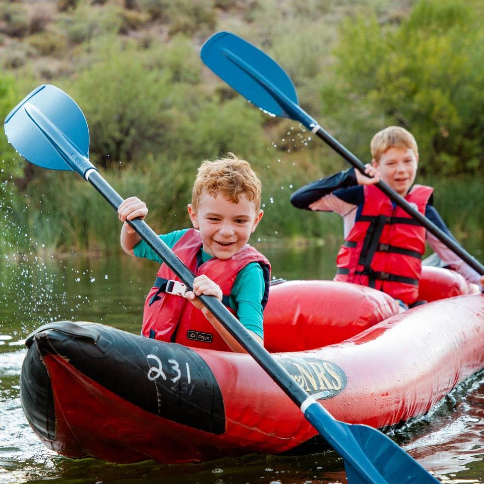 Two young children kayaking near Scottsdale Resort.